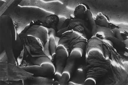 Ernst Haas – Boys lying in the sunshine on the set of Howard Hawks's Land of the Pharaohs. Egypt, 1954