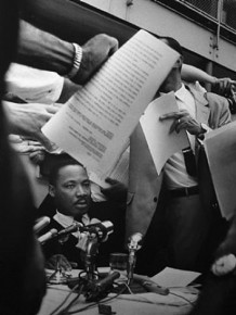 Ernst Haas – Martin Luther King,Jr. besieged by journalists, Burlington, Alabama, 1963