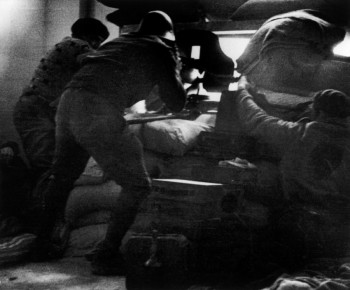 Robert Capa-Republican soldiers aiming machine guns through peepholes. University Residence, Madrid, 1936
